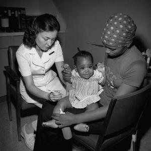 IM Vaccination, 1977. CDC Public Health Image Library. Common domain.