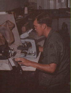 SP4 Francis Heyniger, lab technician, performing a WBC differential on a war dog at the 9th Med Lab, Long Binh, Vietnam.   Photo Credit: Army Medicine